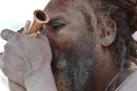 Kolkata, India. 08th January 2018. Naga Sadhus, devotees and rituals at Ganga Sagar Shivir, Outram Ghat transit camp for Ganga Sagar Mela 2018. Stock Photo - 93042359