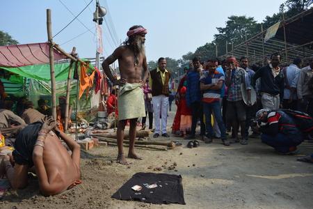 Kolkata, India. 08th January 2018. Naga Sadhus, devotees and rituals at Ganga Sagar Shivir, Outram Ghat transit camp for Ganga Sagar Mela 2018. Stock Photo - 93042363