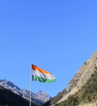 glorious tri color indian national flag waving in the wind near bum la pass, close to the india china international border in tawang, arunachal pradesh, india