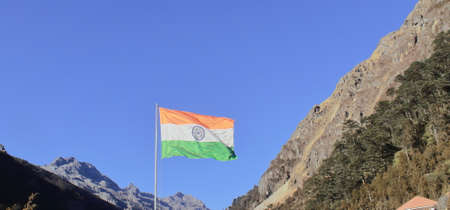 glorious tri color indian national flag waving in the wind near bum la pass, close to the india china international border in tawang, arunachal pradesh, india 스톡 콘텐츠