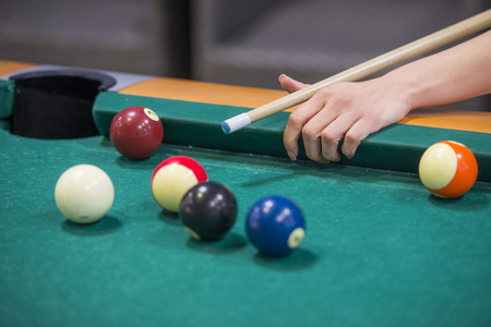 Woman hands on billiard table playing
