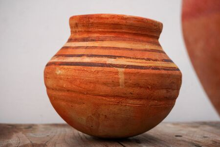 A close up shot of an earthen pot or a clay pot.