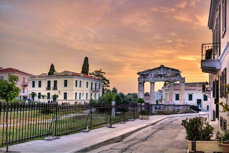 The Gate of Athena Archegetis at sunset at the Roman Agora, Athens, Greece. Stock Photo