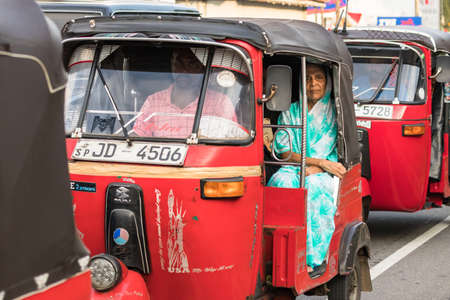 Galle, Sri Lanka - February 18th, 2019: A local sri lankan woman, sitting onboard a tuk tuk at Matara Road in Galle, Sri Lanka.