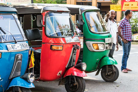 Galle, Sri Lanka - February 17th, 2019: Queue of Tuk Tuk drivers waiting for passengers at the city center of Galle, Sri Lanka.