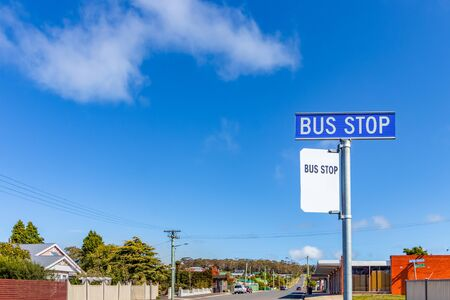 A blue bus stop sign on a side road in Bell Bay, Tasmania, Australia.