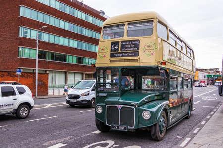 Dublin, Ireland - July 29th, 2019: A Vintage double-decker tea time bus tour in Dublin, Ireland.