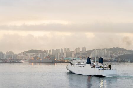 Ship approaching the port of Busan at a cloudy day, South Korea.