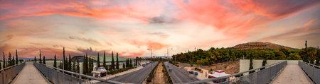 Panoramic view of the Veikou Av and the Veikou pedestrian bridge in Galatsi, Athens, Greece.