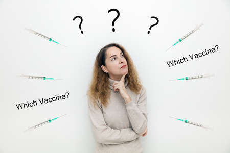 A woman with syringes around her thinking with serious face about question and doubts with hand on chin, thoughtful, confusing.