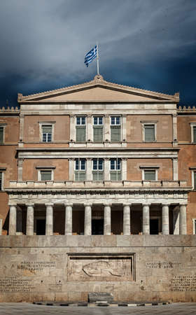 Athens, Greece - May 2021: Greek parliament and the Tomb of the Unknown Soldier at Syntagma square.