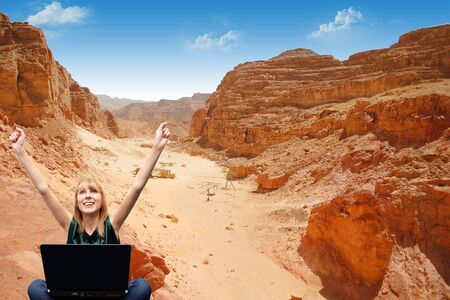 Girl with a laptop in the mountains sent the message     photo
