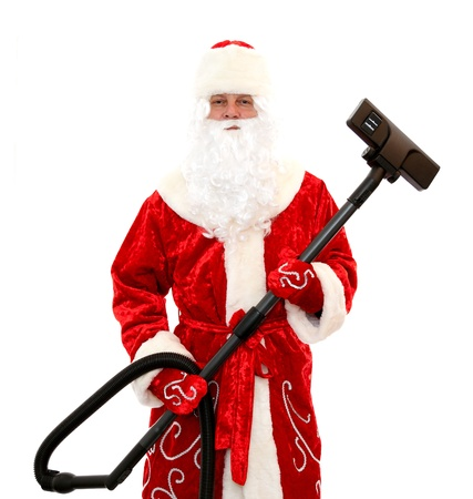 vacuum cleaning: Close-up of Santa Claus with a vacuum cleaner
