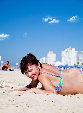 Beautiful woman relaxing on the beach Stock Photo - 8325835