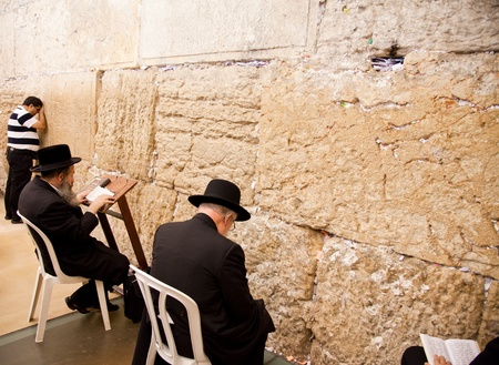 JERUSALEM - NOVEMBER 8: People pray at the Western Wall on Nov. 8, 2010 in Jerusalem, Israel.