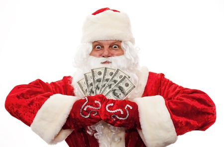 Close up of Santa Claus with money isolated on white photo