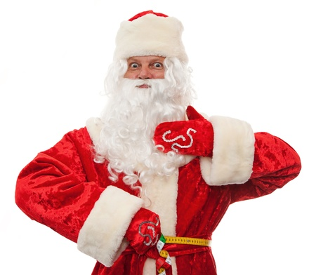 Close up of Santa Claus is measuring your waist, folding ruler isolated on white photo