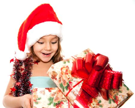 Little girl and boy at Christmas time photo