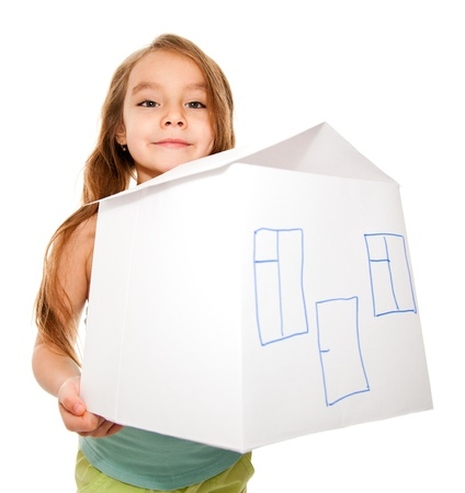 dreamy: Close up of a girl holding a house model isolated on white