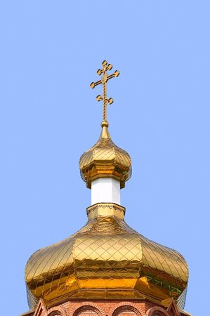 Gold copola. Christianity: ñatholicity or orthodoxy church, cross. Stock Photo