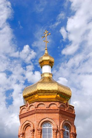 Gold copola. Christianity: ñatholicity or orthodoxy church, Cross on sky background photo