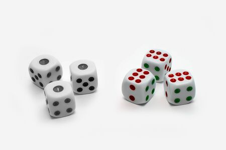 Black-and-white and colorful dices on white background photo