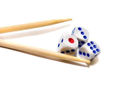 Chopsticks and dices on white background photo