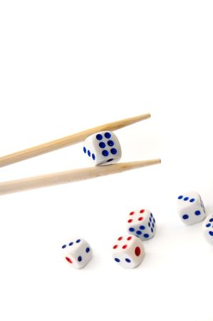 Chopsticks and dices on white background Stock Photo - 3375788