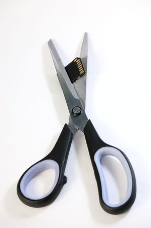 Scissors cuts usb flash memory, isolated on white backround Stock Photo - 3375853