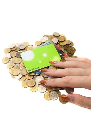 Female hand, coins and cards on white photo