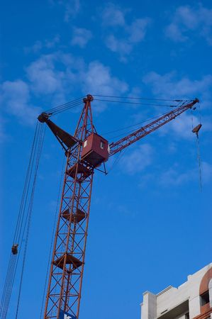 Photo of a tower crane on sky background photo