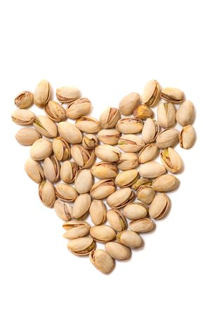 nutty: Lots of pistachio as heart isolated on white