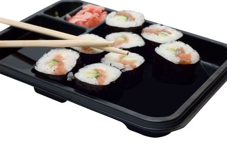 Rolls of sushi on a plate with chopsticks. photo
