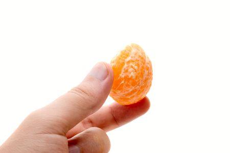 sweet segments: Man hand hold mandarin segment on white background Stock Photo