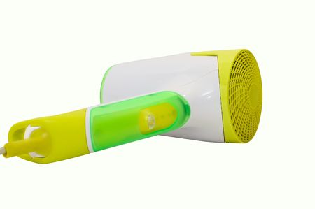 Stylish yellow and green hairdryer on white photo