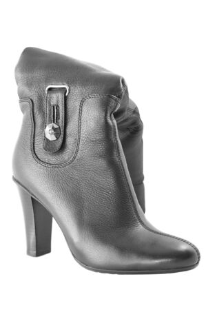 Female boot of black color on white photo