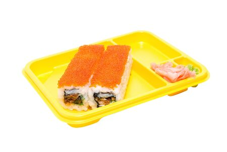 Yellow plate with rolls of sushi on white photo