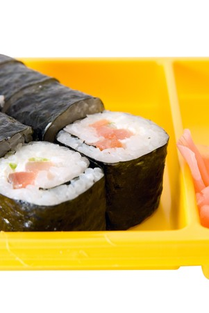 Isolated close up of sushi roll on yellow plate photo