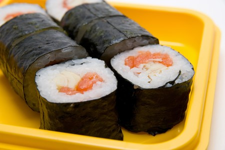 Close up of sushi roll on yellow plate photo