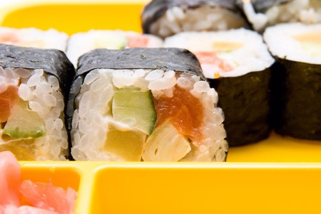 Close up of sushi  on yellow plate photo