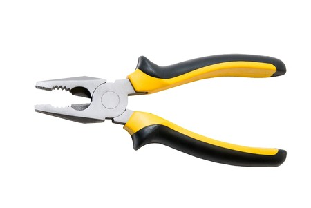 Black and yellow pliers Isolated over white background  photo