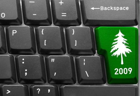 Close-up of computer keyboard with  green Christmas tree key photo