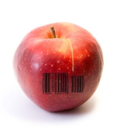 Red apple fruit with barcode isolated on white background photo