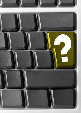Close-up of Computer keyboard,  with yellow Question key photo