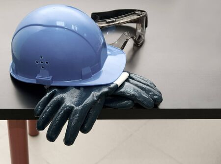 Blue hardhat and  leather gloves  photo