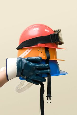 Hand hold three colored helmets photo