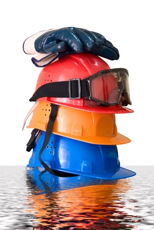 Many colored hardhats, gloves and goggles with reflection photo