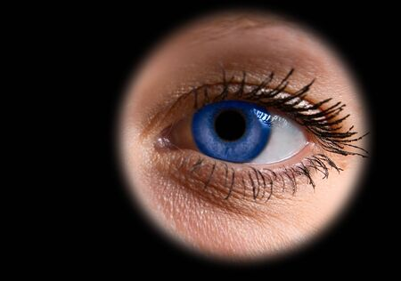 Close up of a blue woman eye on black Stock Photo - 4297866