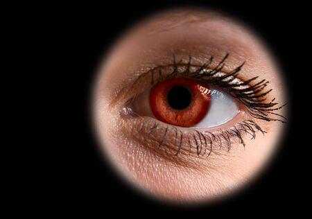 Extreme close-up of red female eye on black Stock Photo - 4297864