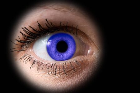 Close up of a woman blue eye on black Stock Photo - 4297868